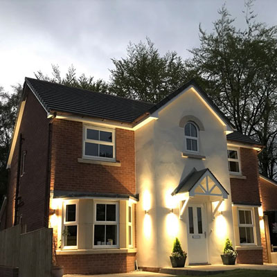 New detatched home in Wrexham lit up at night